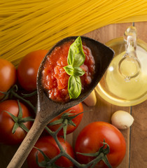 wooden ladle with tomato sauce