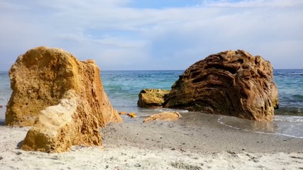 Surf, beautiful yellow stones and blue water