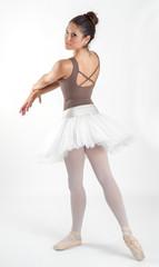 ballet dancer poses in the studio