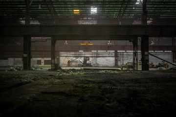 Industrial interior with bulldozer inside