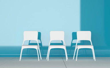 Three modern chairs in a blue room