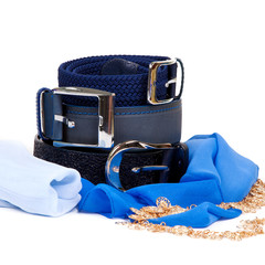 Three leather belt and scarf on a white background