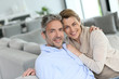 Portrait of mature couple relaxing at home - 81217631