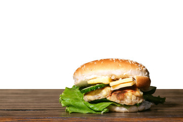 Homemade Cheeseburger on a table with isolated background