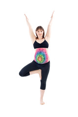 Woman with painted belly doing yoga exercises