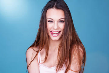 Gorgeous laughing playful young woman