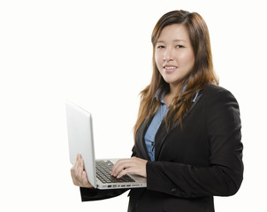 Pretty young adult standing with laptop