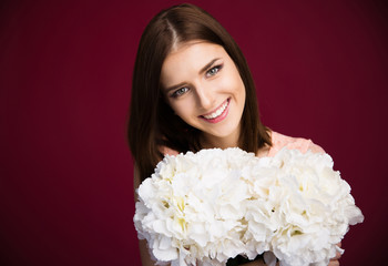 Smiling beautiful woman holding flowers