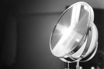Round bathroom mirror with illumination, monochrome