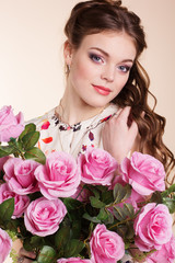 Pretty young girl with pink roses