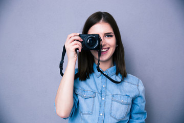 Happy woman making photo on camera