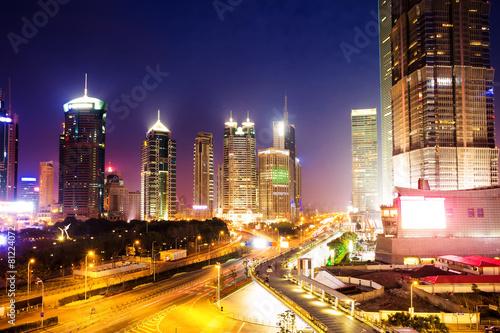 skyline and illuminated cityscape of shanghai at night