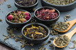 canvas print picture - assortment of dry tea in ceramic bowls