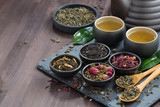 assortment of fragrant dried teas and green tea