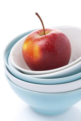 different clean bowl and fresh red apple, isolated