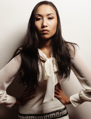 beautiful asian brunette in gorgeous dress