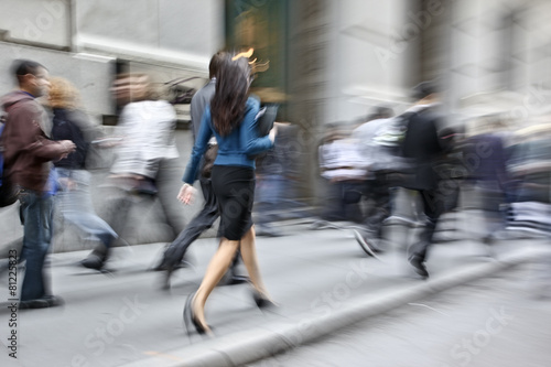 motion blurred business people walking on the street - 81225823