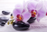 massage stones with orchids