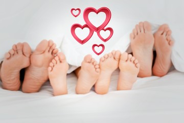 image of  family on the bed at home
