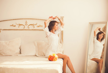 Morning portrait of a cute girl in the bedroom
