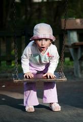 A little girl with swings