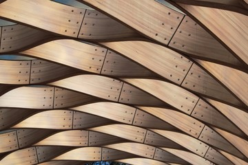 Winding wooden pattern structure. Architect background.