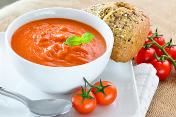 Fresh tomato soup and fresh baked crusty bread rolls.