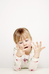 Girl counting fingers
