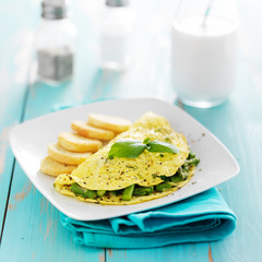 asparagus egg omelet with basil garnish