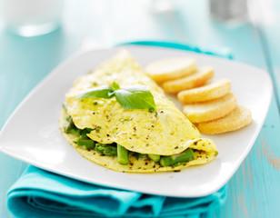 asparagus egg omelet with basil garnish