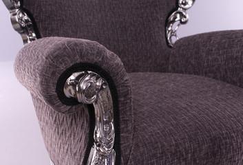 closeup of metal framework on black luxury armchair