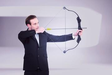 Businessman shooting a bow and arrow