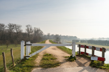 White wooden gate on a dike in the Netherlands