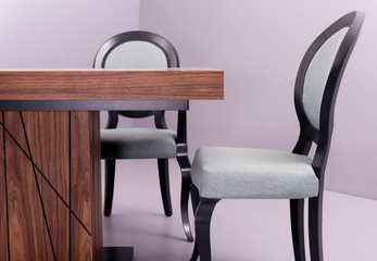 brown wooden table with gray chairs with black frames