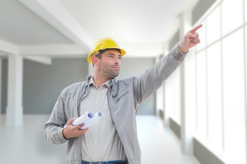 Composite image of architect pointing