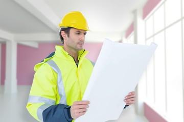 architect analyzing blueprint over white background