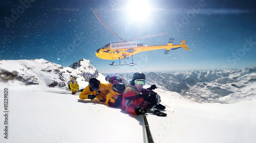 Tuinposter Wintersporten snowboarder were dropped by a helicopter while taking selfie