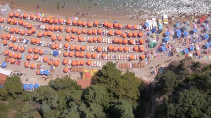 Aerial view of people enjoying on the sea sandy beach