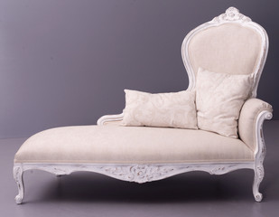 elegant ivory sofa bed with pillows on gray background
