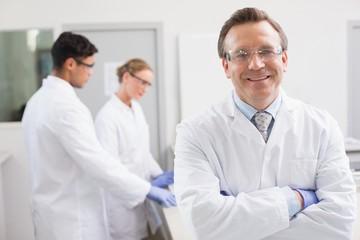 Smiling scientist looking at camera