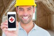 Portrait of smiling handyman showing smartphone