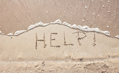 handwriting message word help at sea beach sand