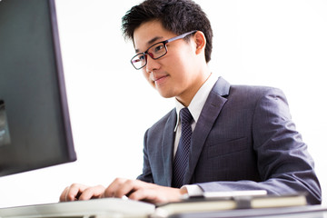 Handsome businessman working with laptop
