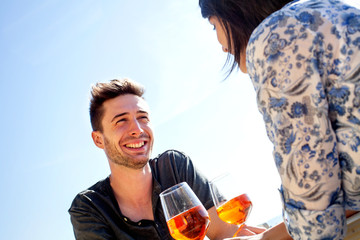 couple having fun while drinking a spritz of beachfront