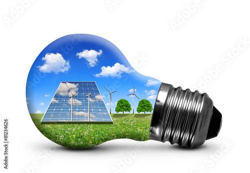 Leinwanddruck Bild Solar panels and wind turbines in light bulb isolated .