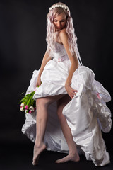 seductive woman in a wedding dress