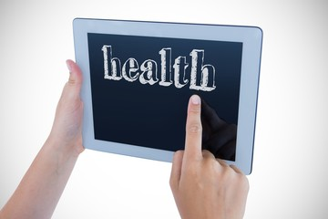 Health against woman using tablet pc