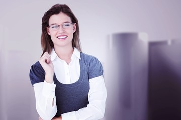 Composite image of smiling woman looking at camera