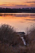 Beautiful lake near city with colorful sunset sky. Tranquil vibr