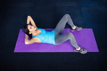Young woman doing exercises abs